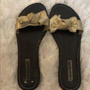 American Eagle Gold Bow flip flops